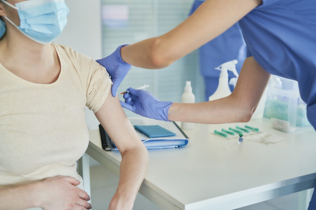 Close up of woman getting vaccinated